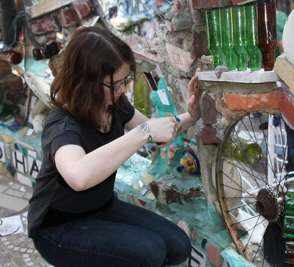 Image of a girl making mosaic art at the Philadelphia's Magic Garden