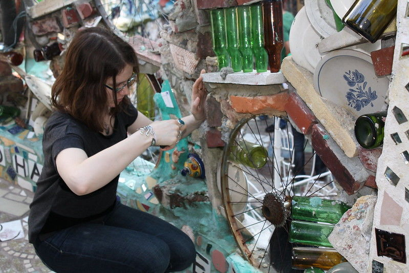 Image of a girl making mosaic art at the Philadelphia's Magic Garden
