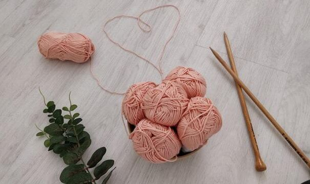 Pink yarn with knitting needles