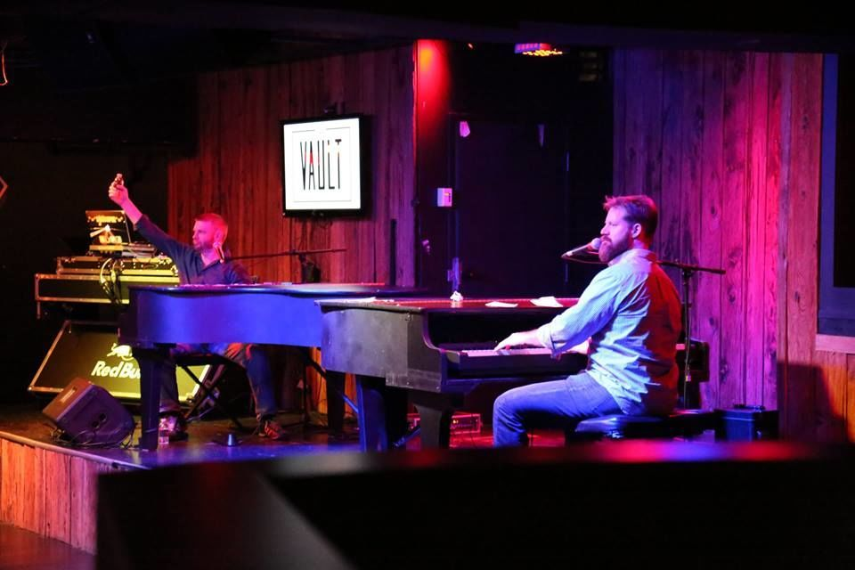 dueling piano performance at the vault nightclub