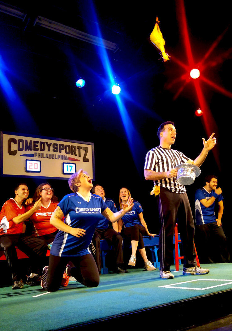 the ref and players from comedysportz celebrate new year s comedysportz philadelphia 1